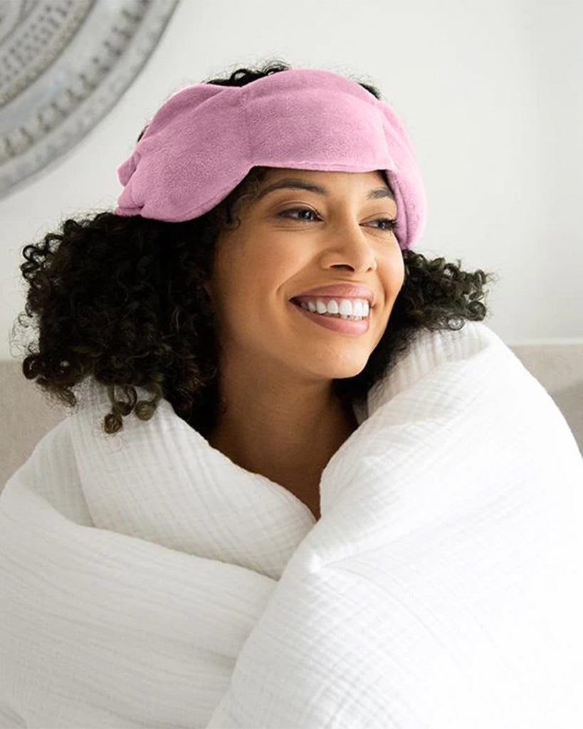 model shown wearing pink weighted sleep mask