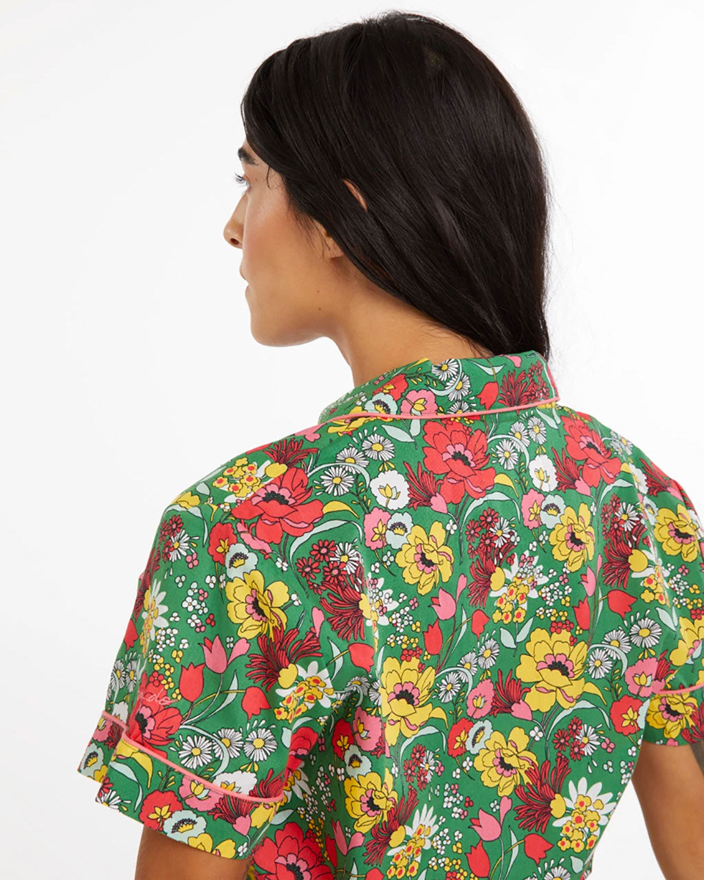 Close up image of our short sleeve emerald floral pattern leisure shirt