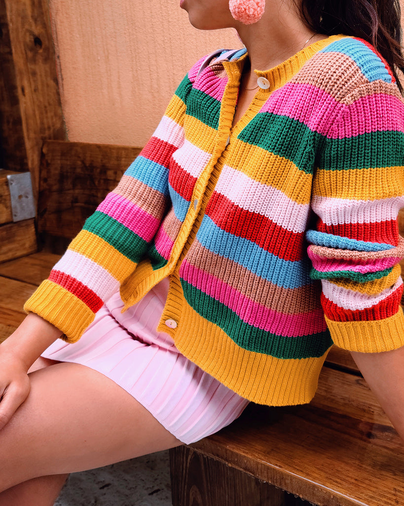 sunset stripe knit cardigan shown on model sitting down