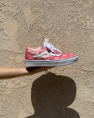 old skool vans with a red and white canvas design