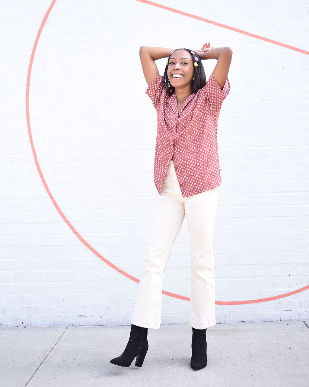 model shown wearing vans button down henna short sleeve shirt with white jeans