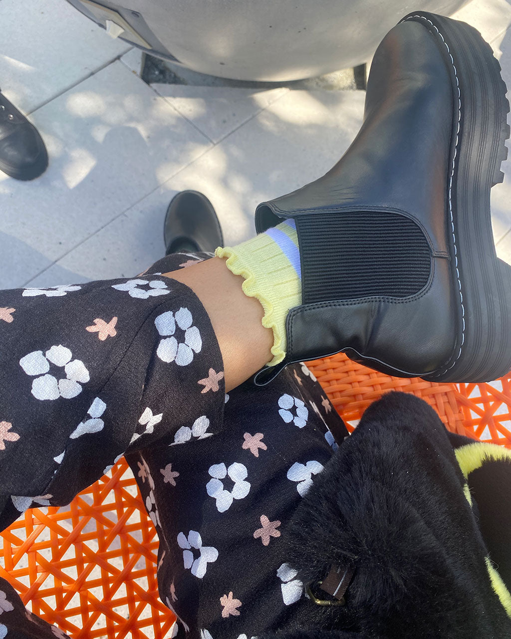 yellow pear socks shown with black boots on model