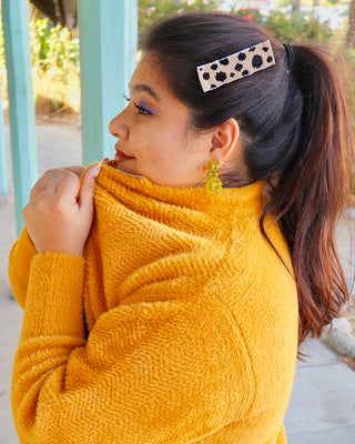 model shown wearing beaded black polka dot hair clip