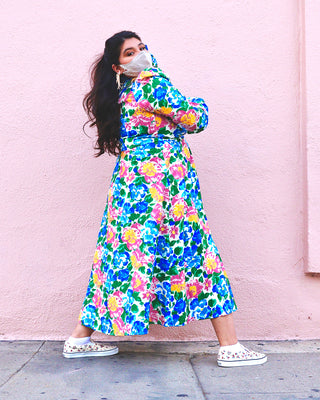 model shown wearing bright floral midi dress
