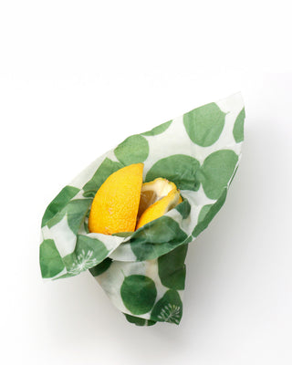 food wrap with a leafy pattern shown around lemons