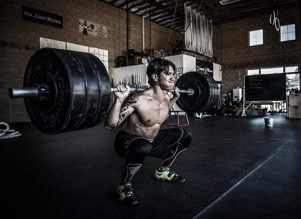 Put the Weight of the World on Your Shoulders to Improve in Crossfit