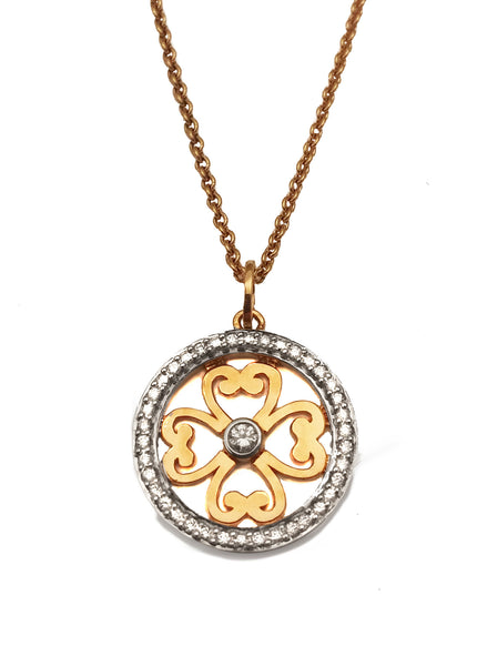 18 carat rose gold filigree pendant surrounded with diamonds