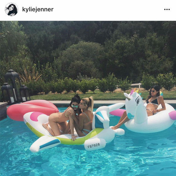 Spotted: Kylie Jenner on the FUNBOY Lips and Rainbow Unicorn Pool Float