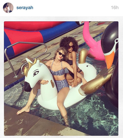 Taylor Swift and Serayah ride the FUNBOY Pegasus float.