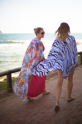 Wind blowing kaftans along the beach
