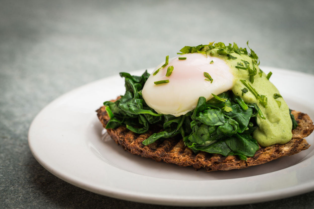 Brunch eggs florentine with avocado and cashew hollandaise sauce