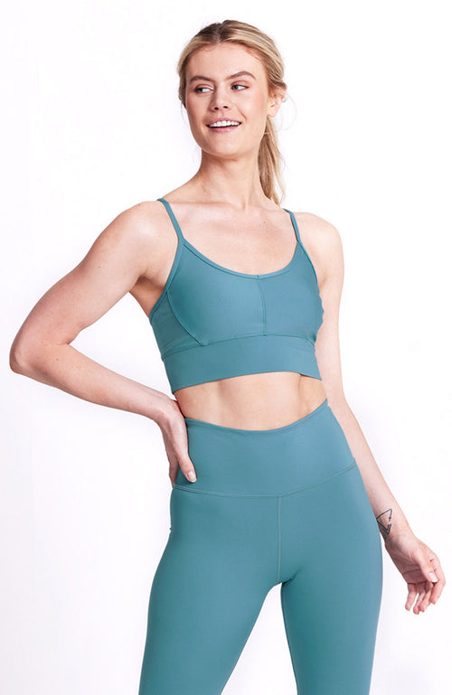 medium impact, teal, crop sports bra. Sustainable and ethical.