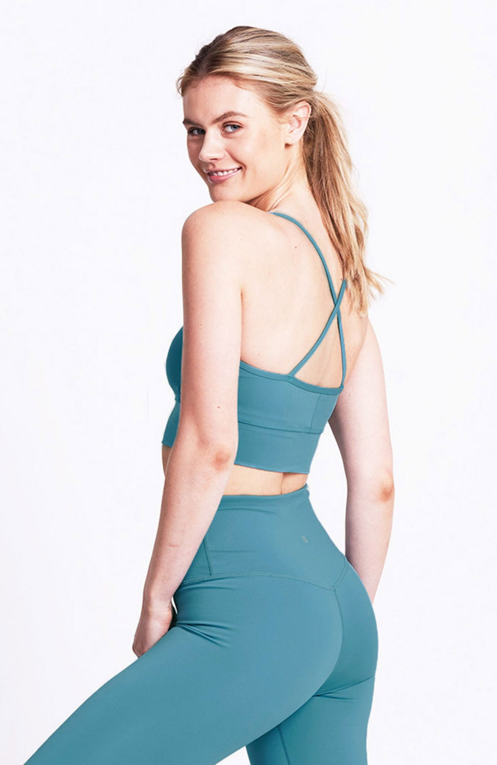 Criss-cross strap, medium impact, teal, crop sports bra. Sustainable and ethical.
