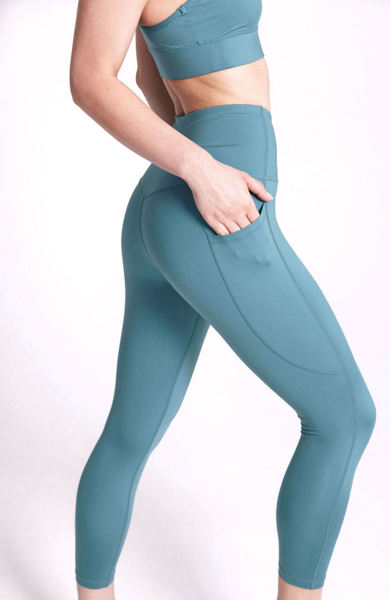 High Waisted, plain teal, 7/8 length legging with dual pockets. Sustainable and ethical.