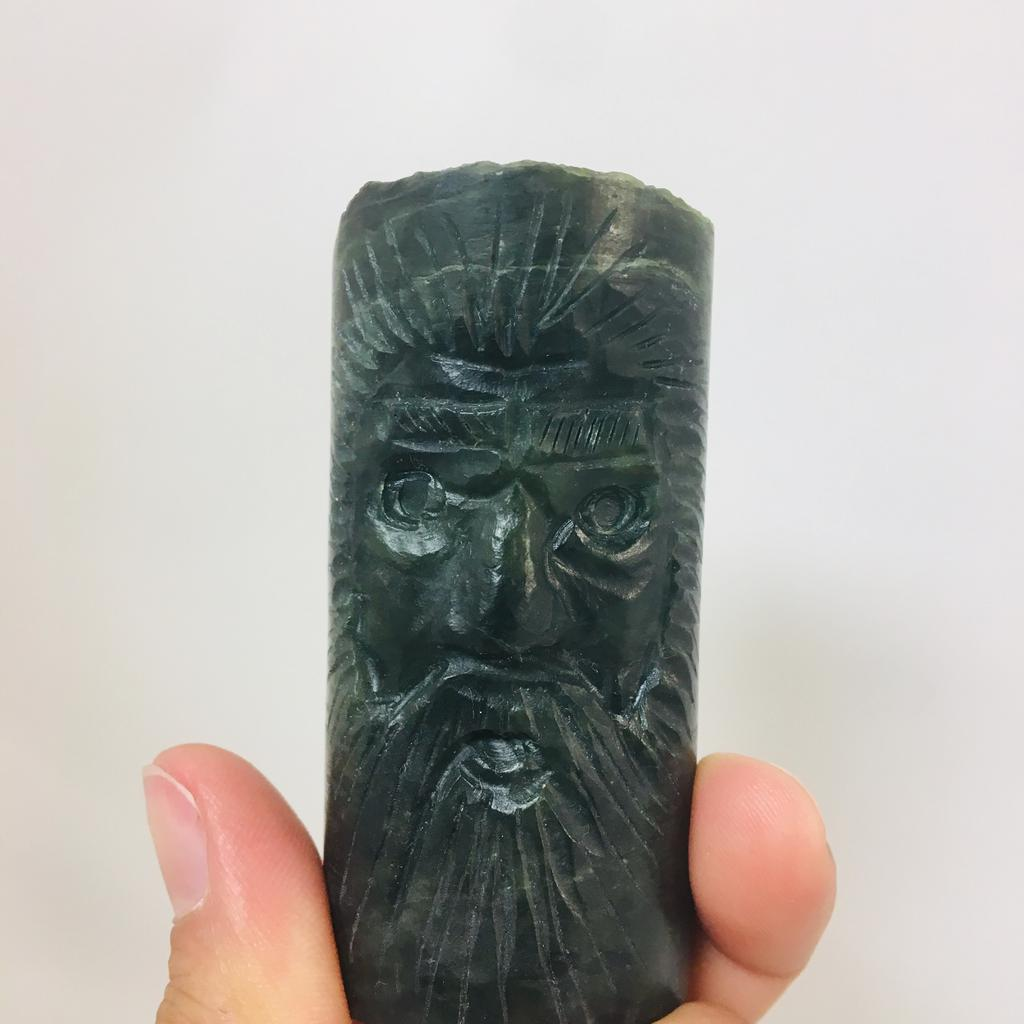 Jade 'old man face', carved in small core sample