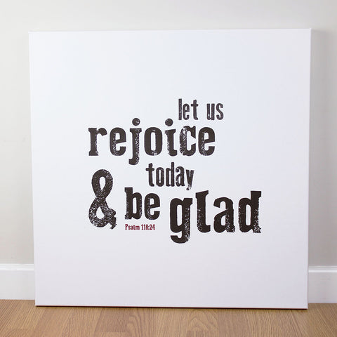 Christian wall art featuring scripture verse from Psalms. 'Let us rejoice today and be glad'. Printed on quality canvas and hand-stretched. Stunning black on white contemporary design. 4 sizes. Free Delivery.