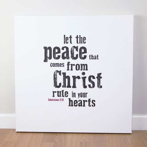 Christian wall art featuring scripture verse from Colossians. 'Let the peace that comes from Christ rule in your hearts'. Printed on quality canvas and hand-stretched. Stunning black on white contemporary design. 4 sizes. Free Delivery.