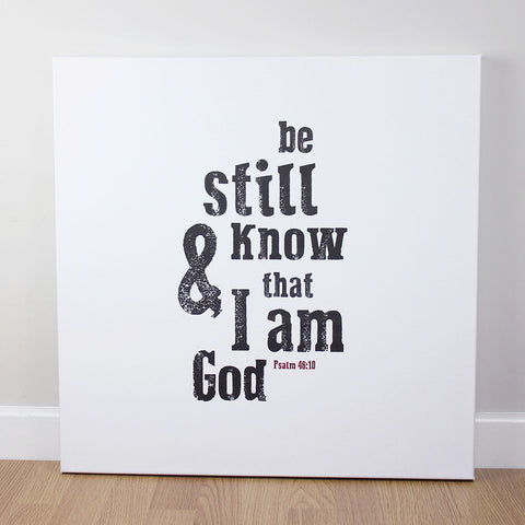 Christian wall art featuring scripture verse from Psalms. 'Be still and know that I am God'. Printed on quality canvas and hand-stretched. Stunning black on white contemporary design. 4 sizes. Free Delivery.