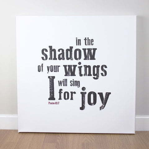 Christian wall art featuring scripture verse from Psalms. 'In the shadow of your wings I will sing for joy'. Printed on quality canvas and hand-stretched. Stunning black on white contemporary design. 4 sizes. Free Delivery.