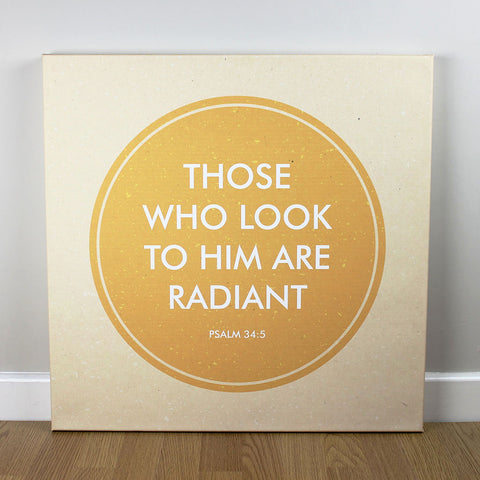 Christian wall art featuring scripture verse from Psalms. 'Those who look to him are radiant'. Printed on quality canvas and hand-stretched. Bold, contemporary, coloured designs on soft, natural brown. 4 sizes. Free Delivery.