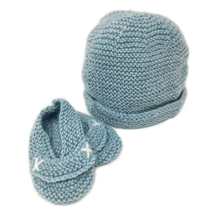hand knitted baby booties in soft blue