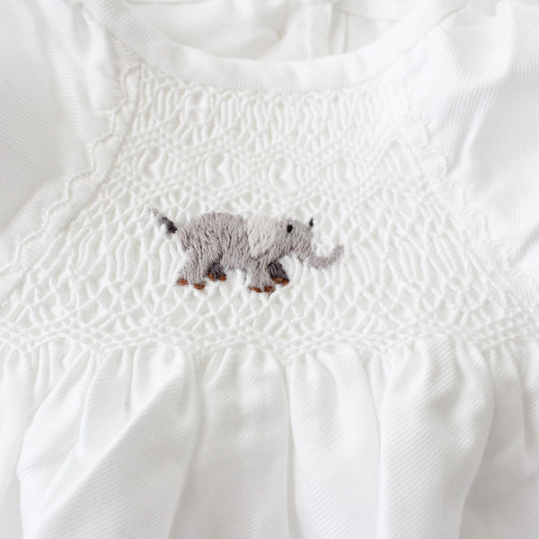 smocked baby gown with embroidered baby elephant