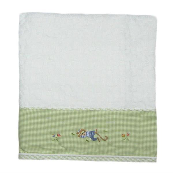 sleeping monkey baby blanket with beige trim