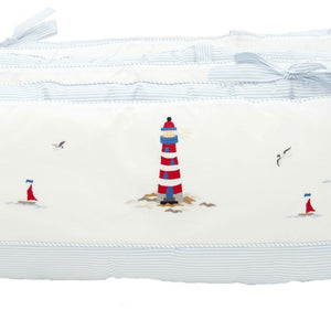 white sailing away crib bumper with blue trim