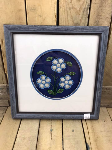 White and Blue Flower with Green Leaves Design Moose Hair Tufting and Beadwork with Blue Background in White Matting in Blue Frame.