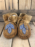 Traditional moose hide child moccasin with blue and clear beads