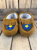 Moose hide and commercial hide child moccasins with 2 tone blue flower