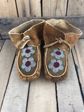 Child moose hide moccasin with flowers