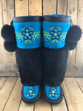 Bright blue stroud and black leather mukluks with black rabbit fur