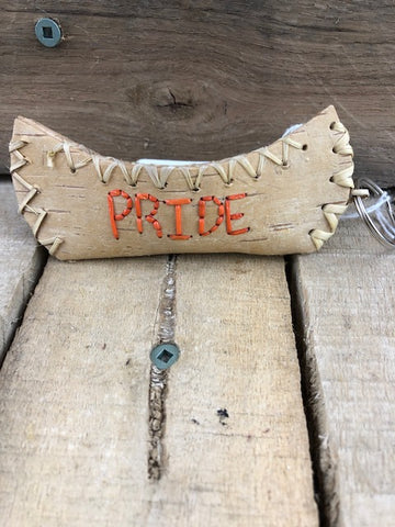 Birch bark canoe key ring with Pride in orange stitching