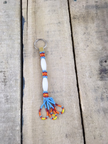 Large White Bead Ornamental Keychain with Blue/Red and Orange Beads