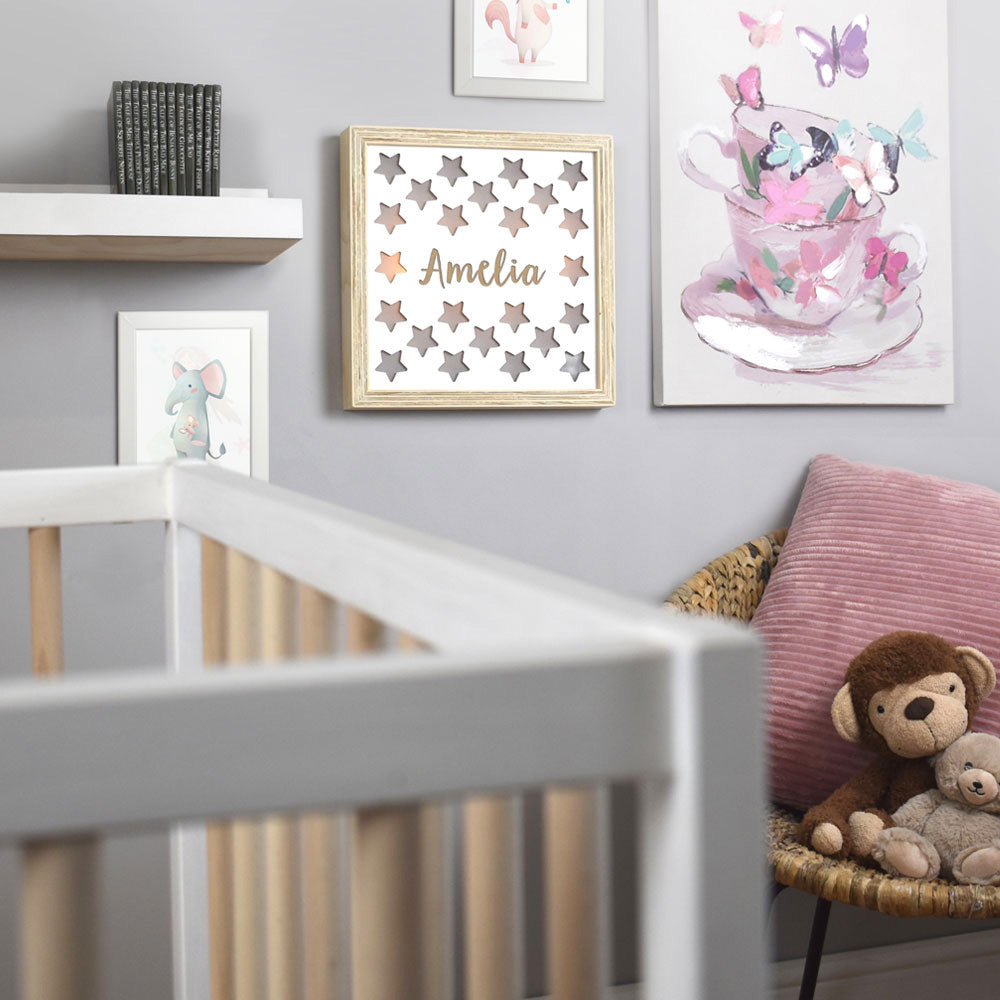 Nursery room with a display wall with hanging star light box.