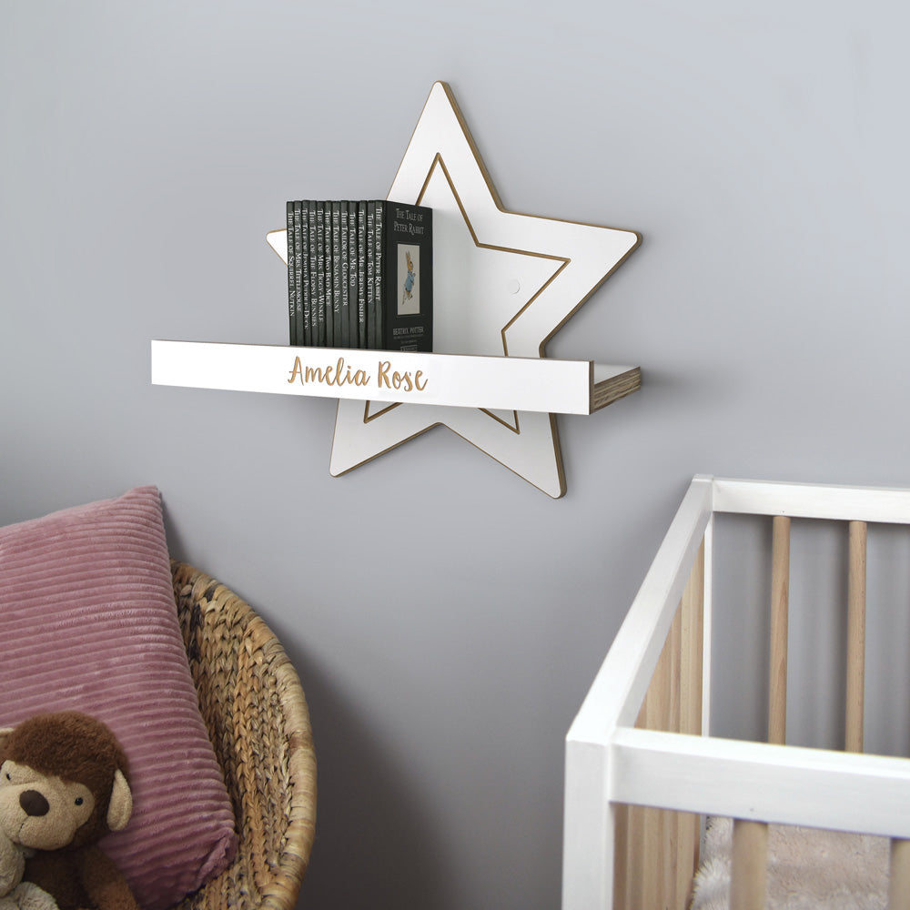 Nursery room scene with personalised wall mounted star shelf.