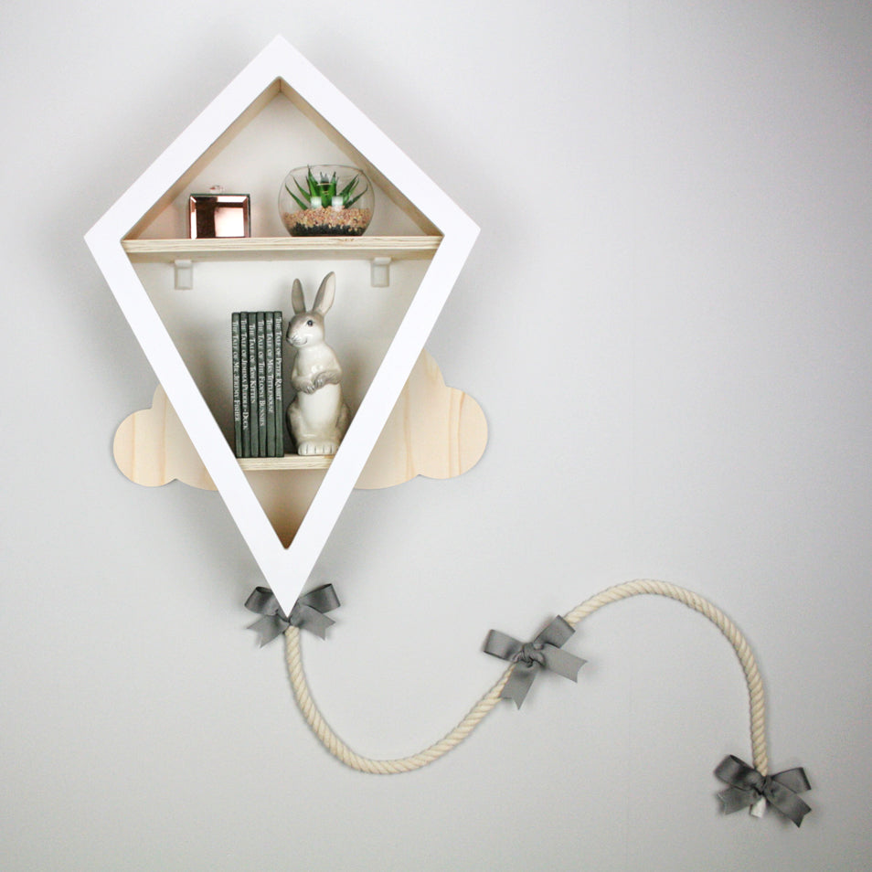 Nursery furniture kite shaped shelf in white and wood colour.