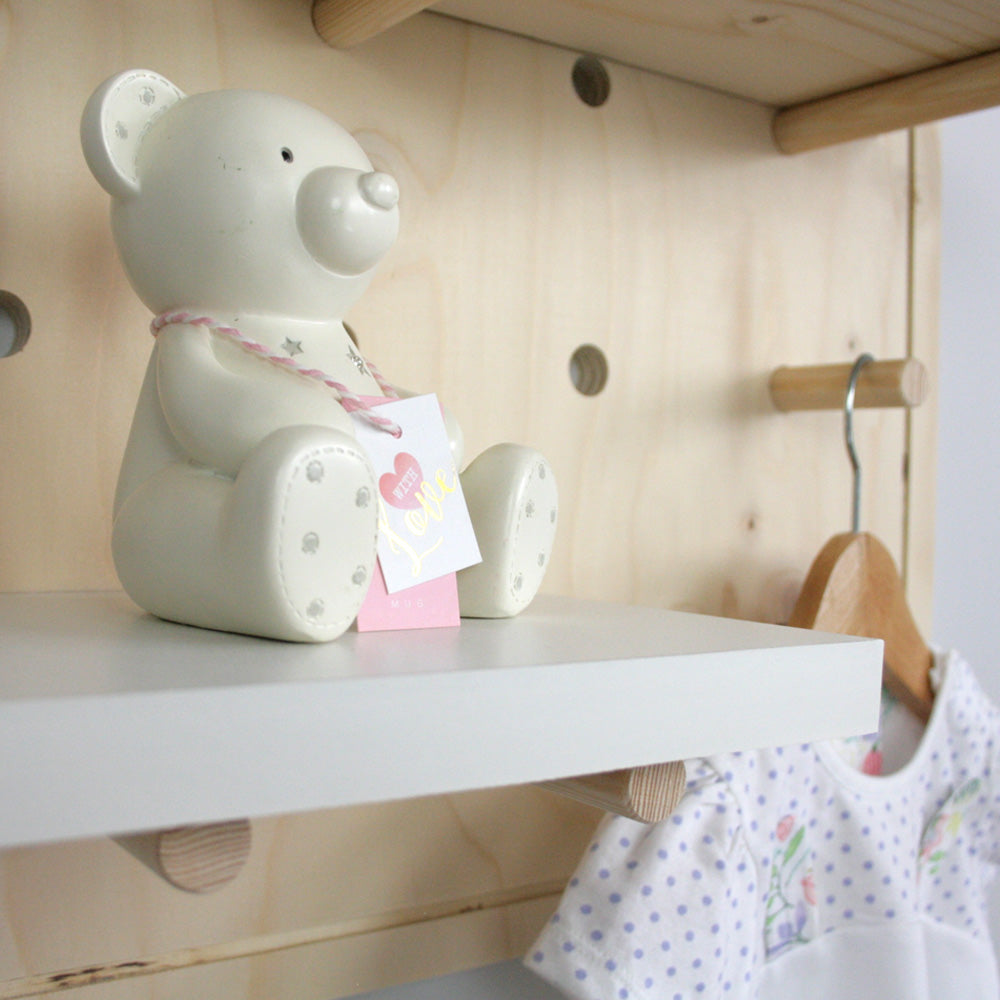 Nursery pegboard wall mounted shelving unit shelf display.