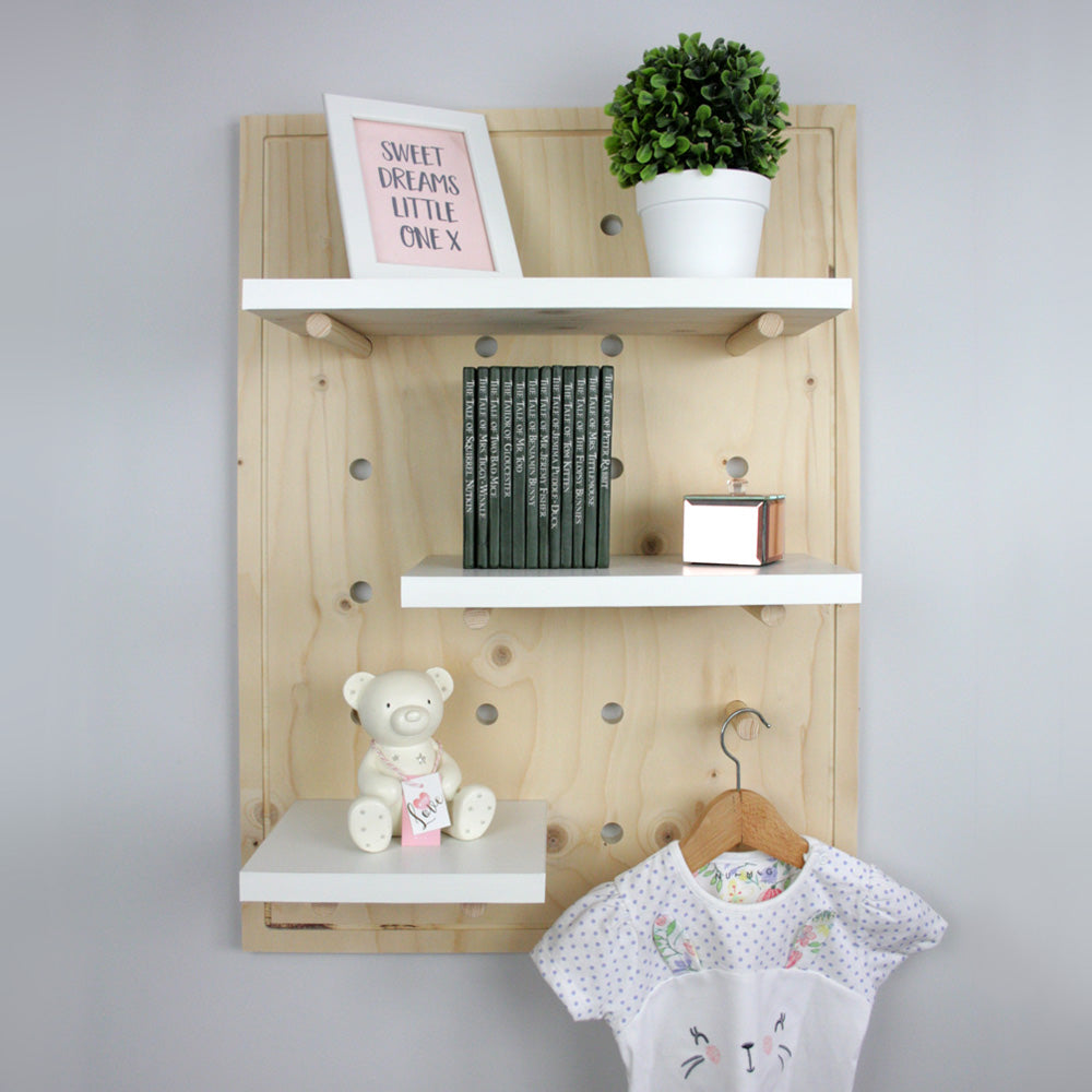 Nursery pegboard wall mounted shelving unit.