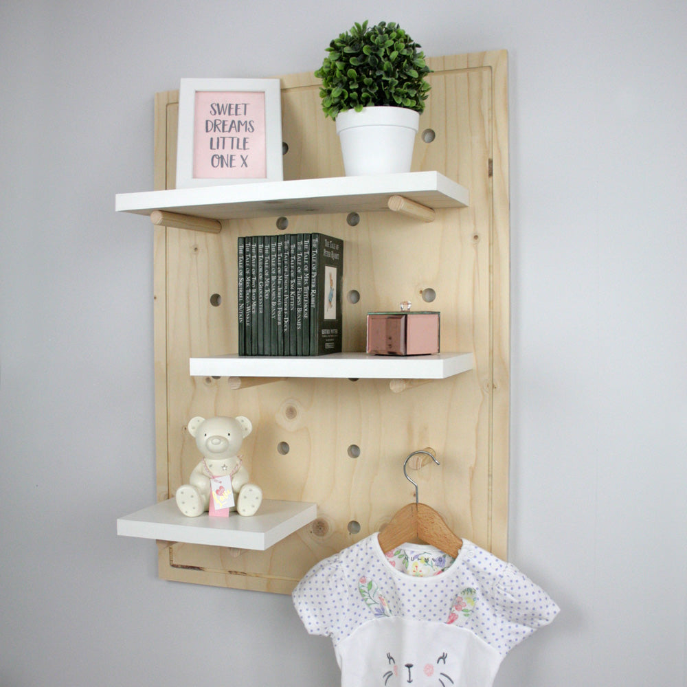 Nursery pegboard wall mounted shelving unit side view.