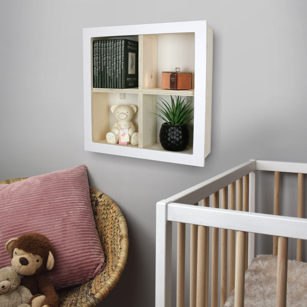 Nursery window box shaped wall mounted shelf in nursery room setting.