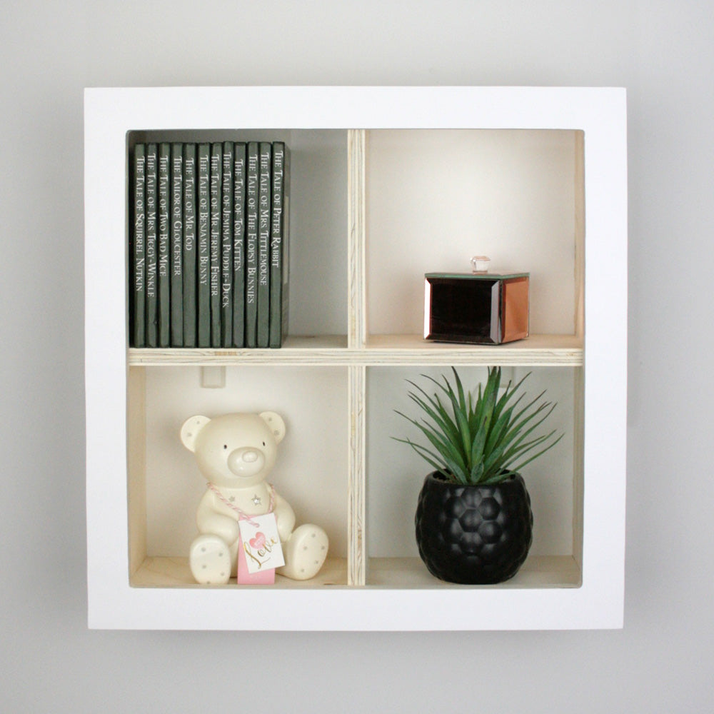 Nursery window box shaped wall mounted shelf.