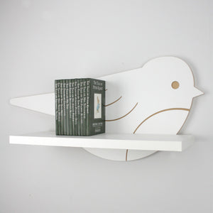 Nursery themed bird shaped wall mounted shelf with side view.