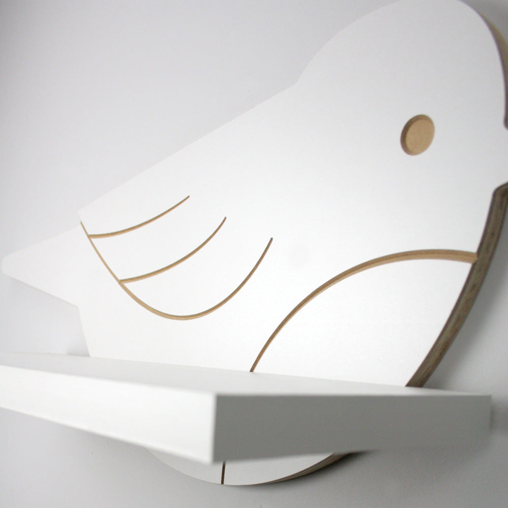 Nursery themed bird shaped wall mounted shelf with close up engraved detail.