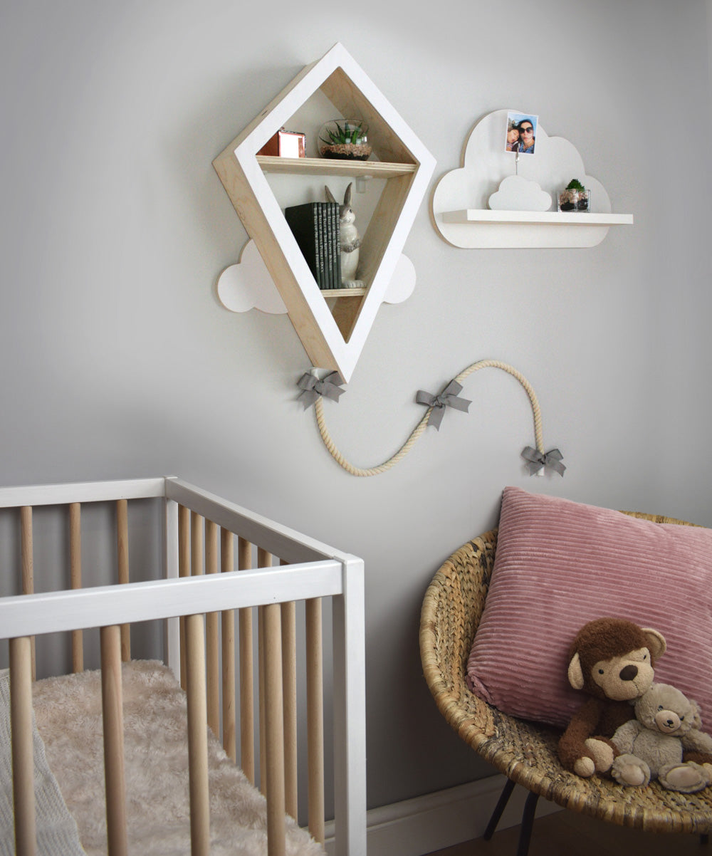 Wall mounted kite book shelf in nursery setting with cloud shelf theme.