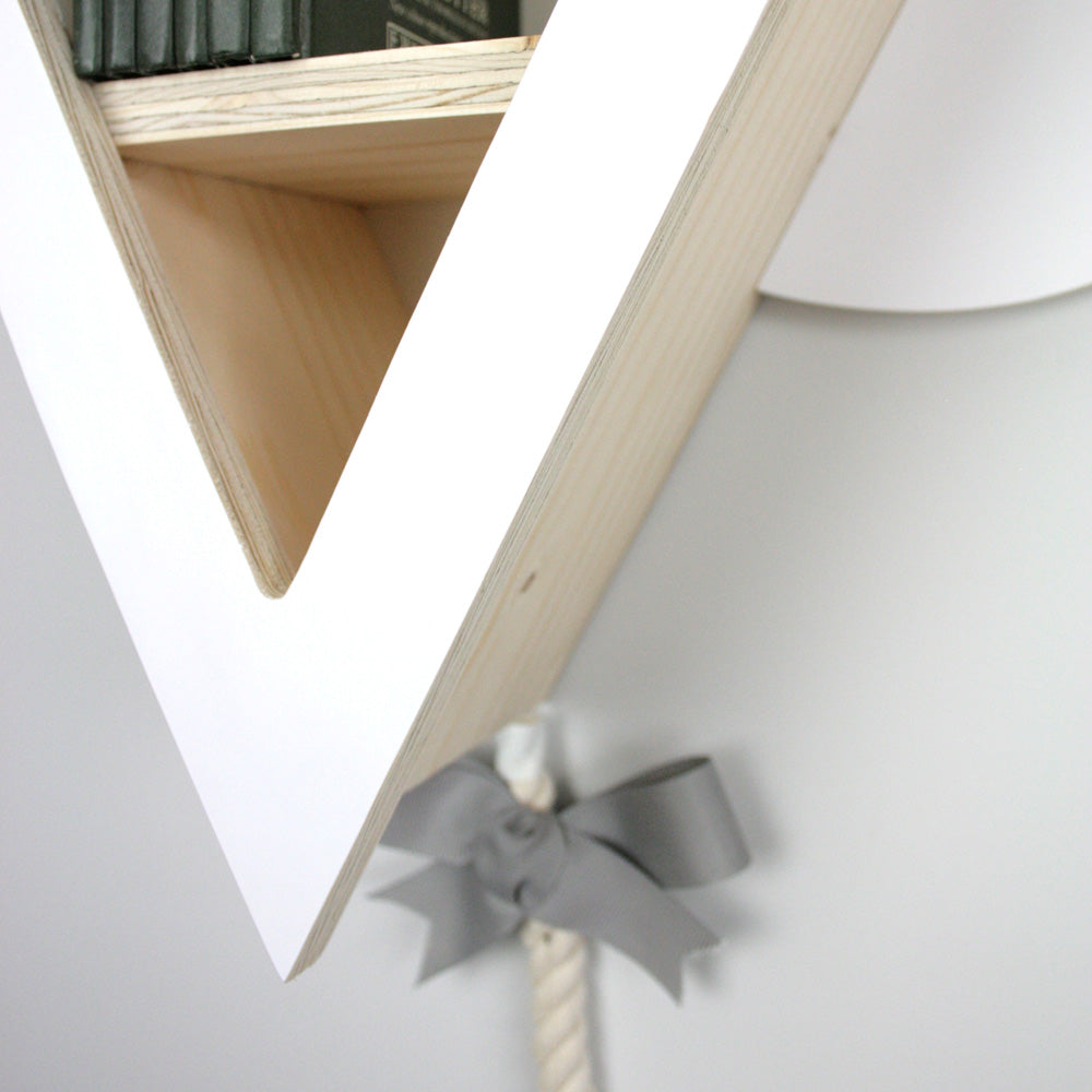 Wall mounted kite book shelf close up bottom detail.