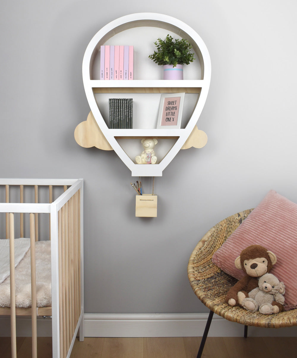 Nursery deco ideas for feature wall mounted hot air balloon shape themed shelf.
