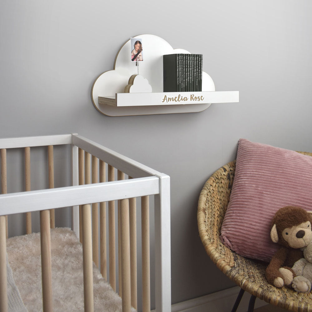 Floating cloud shelf mounted on nursery wall.