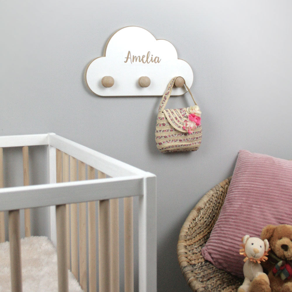 Cloud shaped wall hangers in nursery room.